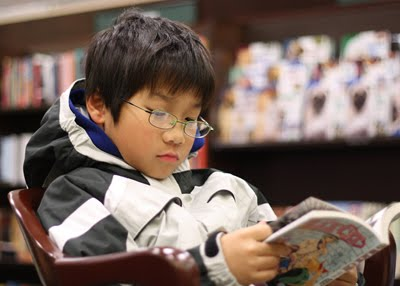 young boy reading