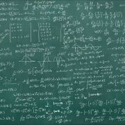hard math equations on a chalkboard