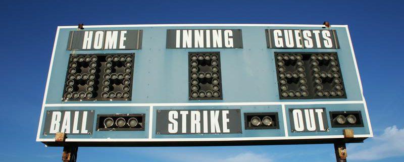 scoreboard with blue sky